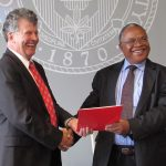 David Williams, Dean of Ohio State's College of Engineering (left) shakes hands with then Tanzanian Minister of Water and Irrigation Jumanne Maghembe after signing a Letter of Intent in 2015.